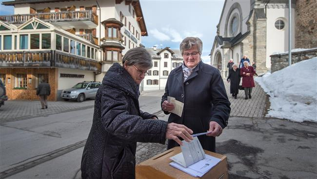 Switzerland votes to ease citizenship