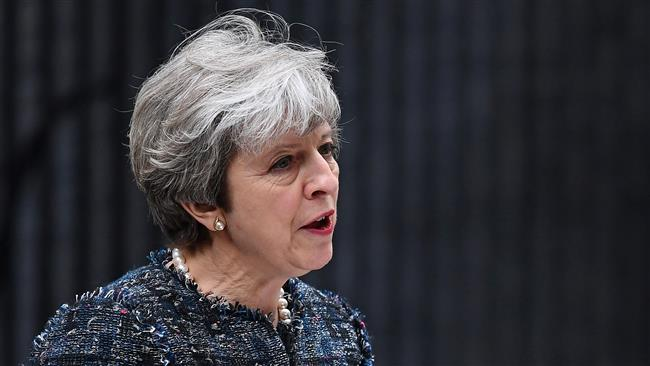 May accuses EU of influencing UK election, lashes out at media