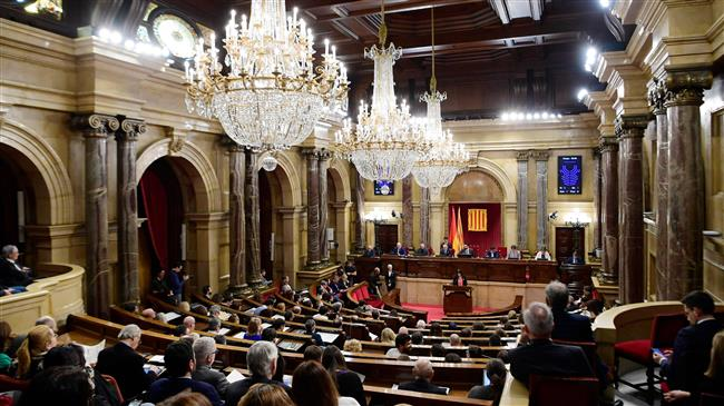 Catalonia parliament backs Puigdemont's right to lead