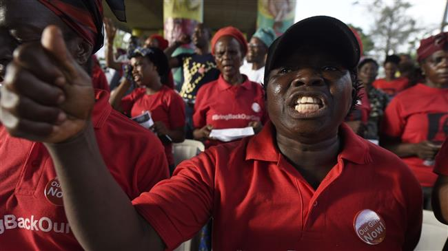 Nigerians mark 4th anniv. of abduction of 200 girls as Buhari begs for patience