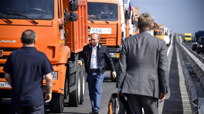 Russia: President Putin drives truck over bridge linking Russia to Crimea