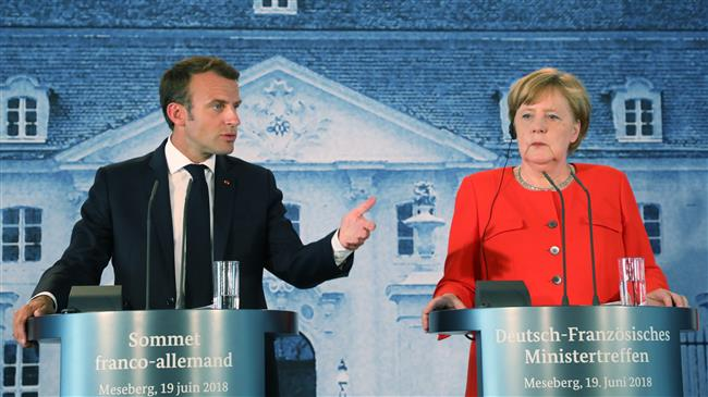 Europe: German Chancellor Merkel says she and Macron 'wrestle' on policy issues