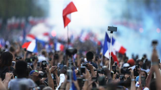 France: Fans welcome their World Cup champions on the Champs Elysees