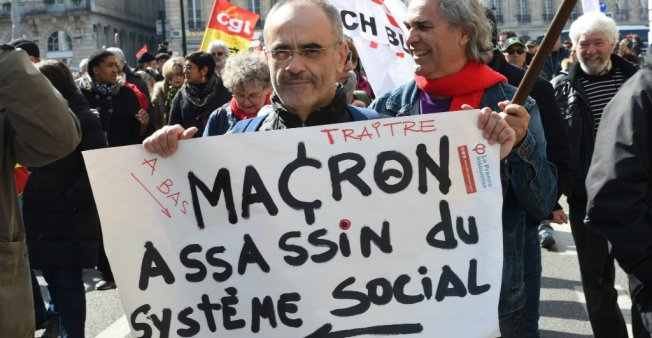 French unions to strike over Macron's 'destruction of social model'