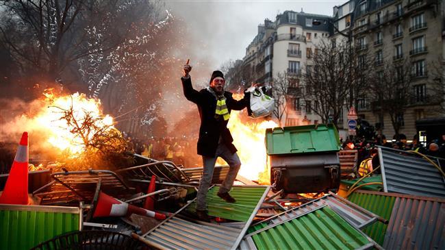 Paris: Tear gas billows as 'Yellow Vests' protest against President Macron