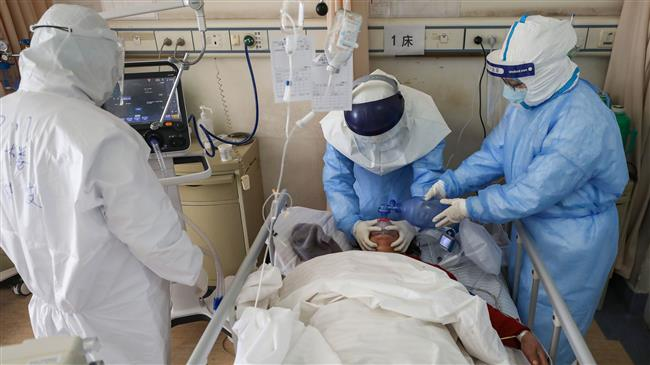 China reports rise in new virus cases as death toll nears 1,800