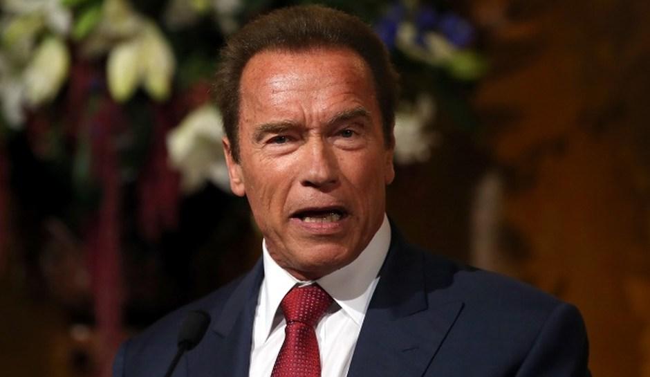 Schwarzenegger chased by an elephant