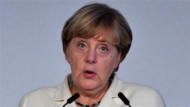 German Chancellor Merkel in hot water over refugee policy