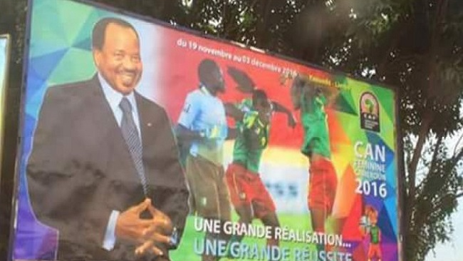 Posters for the Female Africa Cup of Nations presents tournament as a Biya achievement