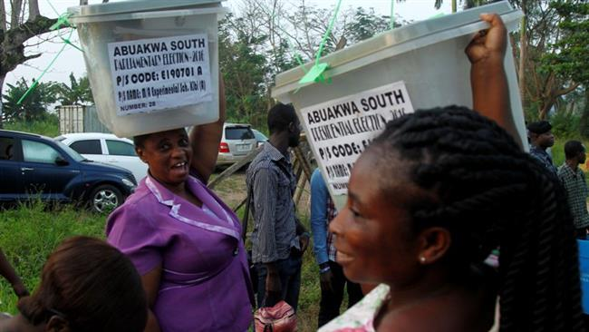 Ghanaians voting in presidential and parliamentary elections
