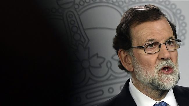 Spanish premier dismisses Catalan government, parliament