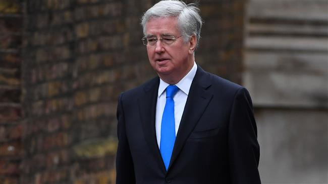 British Defense Secretary resigns over repeatedly touching journalist's knee