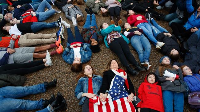 US students stage lie-in protest in front of the White House after Florida school shooting