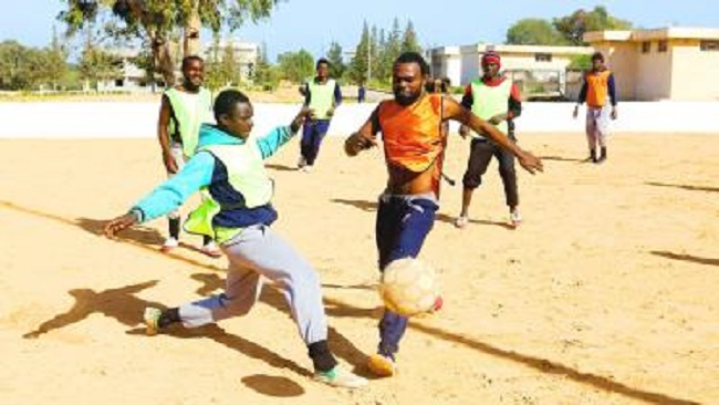 """Victims of poor governance: """"Indomitable lions"""" dream of glory in Libya camp"""
