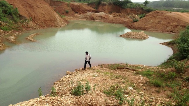 After the gold rush: Mining boom in Cameroon leaves 'open tombs'