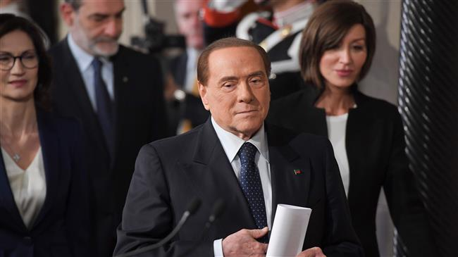 Italy's Berlusconi to face trial on bribery charges