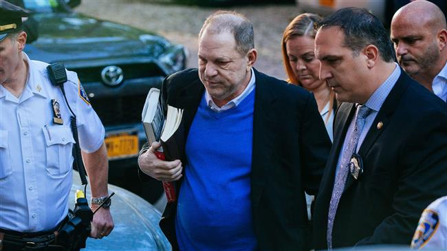 Harvey Weinstein arrested, charged with rape, other sex offences