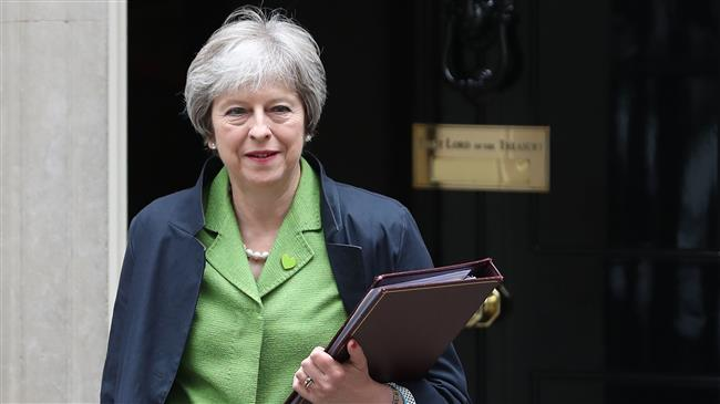 May defuses revolt in parliament over Brexit plans