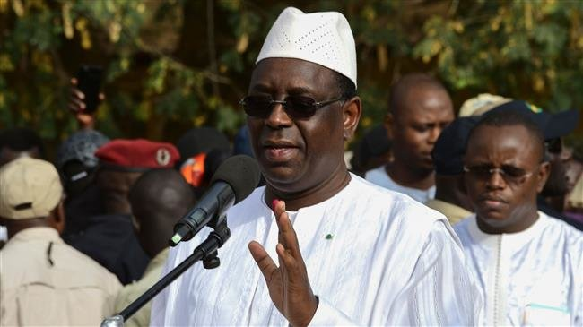 Senegal president's camp claims re-election, opposition objects