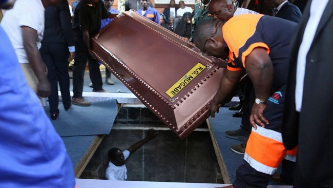 Zimbabwe: Robert Mugabe buried in a steel coffin as family claims people are 'after his body'