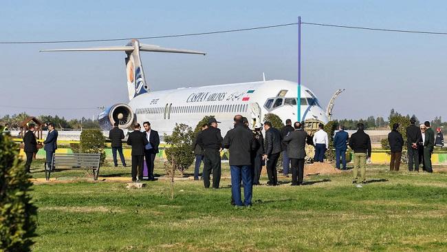Iran airliner overshoots runway, stops in highway