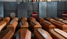 Italy's dead overwhelm morgues as virus toll tops 8,000