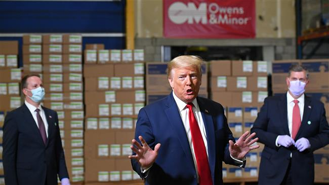 Without wearing a mask, Trump tours Pennsylvania mask distribution center