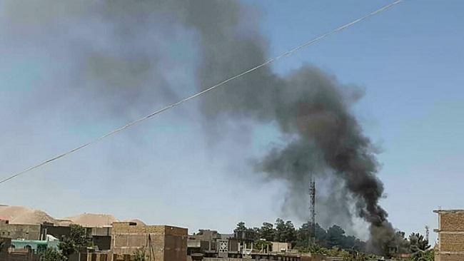 Taliban capture key border crossing as Biden defends Afghan withdrawal