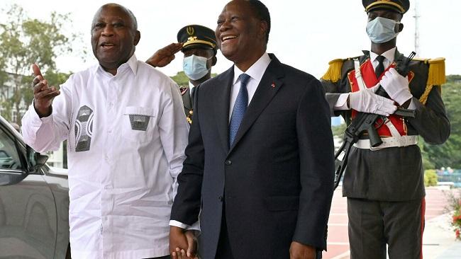 Smiles and hugs as Ivory Coast President Ouattara greets longtime foe Gbagbo
