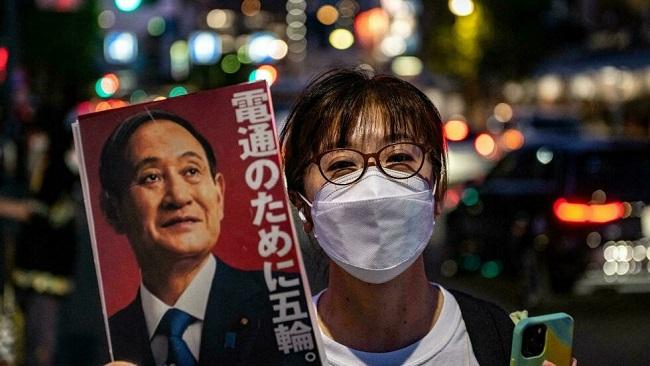 Japan PM denies IOC pressure to hold Olympics